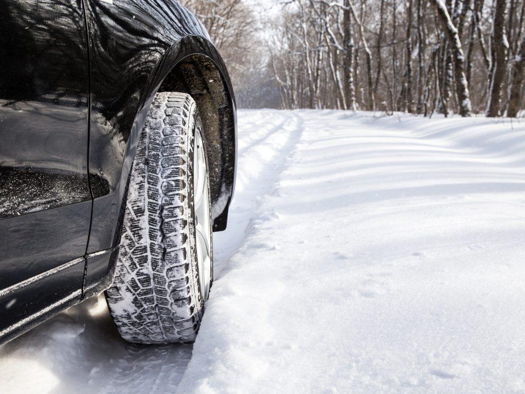 Car Driving Through Snow